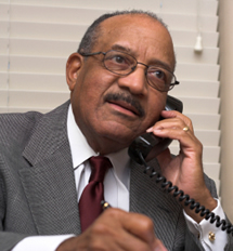 Man using telephone calling features